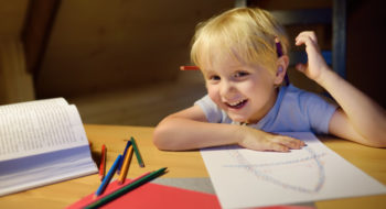 little-boy-doing-homework-painting-writing-home-evening-preschooler-learn-lessons-draw-color-image-kid-training-write-read_107864-1529